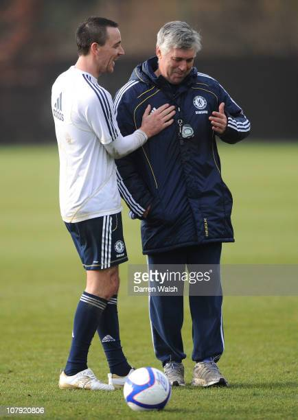John Terry Carlo Ancelotti of Chelsea have fun after a training session at the Cobham training ground on January 7 2011 in Cobham England