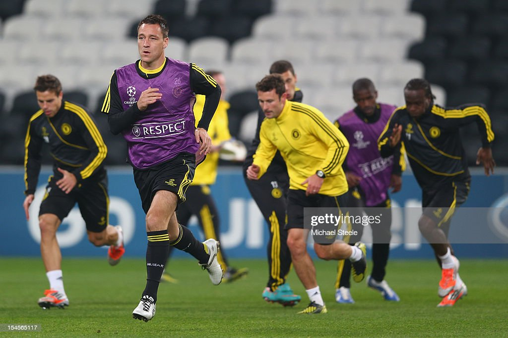 <a gi-track='captionPersonalityLinkClicked' href=/galleries/search?phrase=John+Terry&family=editorial&specificpeople=171535 ng-click='$event.stopPropagation()'>John Terry</a> (2L) during the Chelsea Training session ahead of the UEFA Champions League Group E match between Shakhtar Donetsk and Chelsea at Donbass Arena on October 22, 2012 in Donetsk, Ukraine.