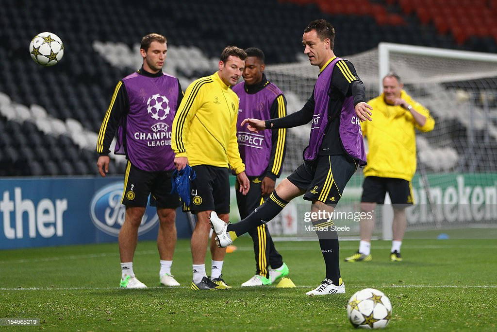 <a gi-track='captionPersonalityLinkClicked' href=/galleries/search?phrase=John+Terry&family=editorial&specificpeople=171535 ng-click='$event.stopPropagation()'>John Terry</a> (R) during the Chelsea Training session ahead of the UEFA Champions League Group E match between Shakhtar Donetsk and Chelsea at Donbass Arena on October 22, 2012 in Donetsk, Ukraine.