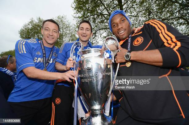 John Terry Frank Lampard and Didier Drogba pose with the Champions League trophy during the Chelsea victory parade following their UEFA Champions...