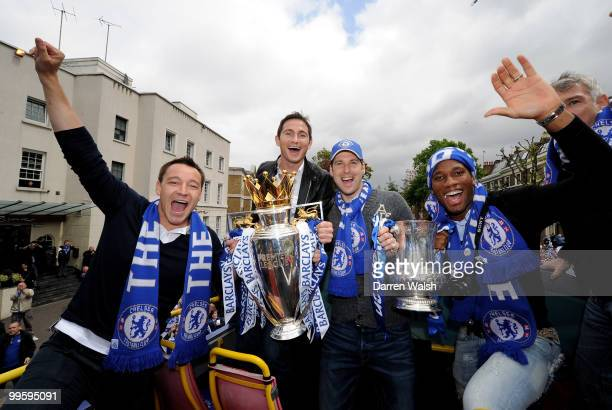 John Terry Frank Lampard Petr Cech and Didier Drogba of Chelsea pose with the Premier League and FA Cup trophies during the Chelsea Football Club...