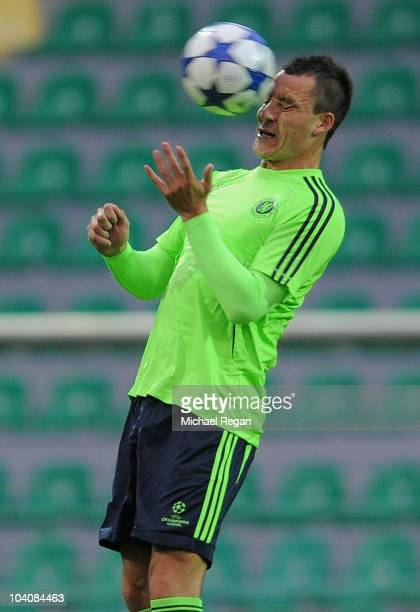 John Terry heads the ball during the Chelsea training session at Stadium Pod Dubnom on September 14 2010 in Zilina Slovakia