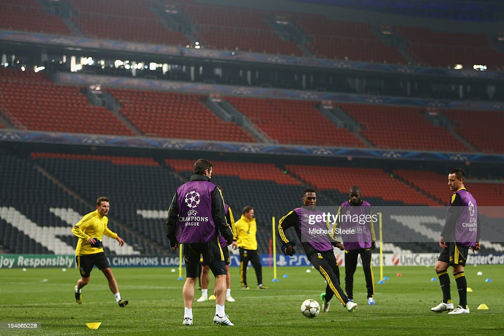 John Terry (R) looks on as Dean Sturridge (C) chases a ball during the Chelsea Training session ahead of the UEFA Champions League Group E match between Shakhtar Donetsk and Chelsea at Donbass Arena on October 22, 2012 in Donetsk, Ukraine.