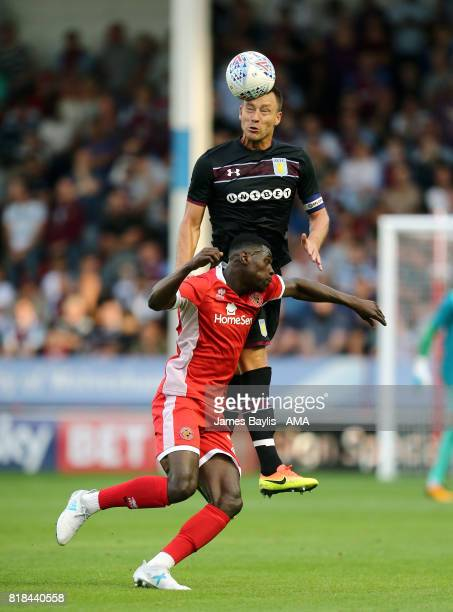 John Terry of Aston Villa and Amadou Bakayoko of Walsall during the preseason friendly match between Walsall and Aston Villa at Banks' Stadium on...