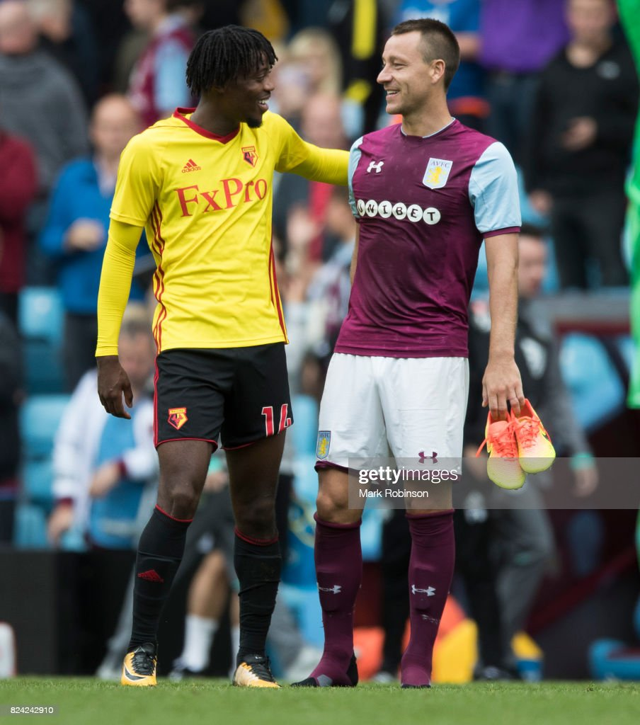 John Terry of Aston Villa and Nathaniel Chalobah of Watford chat at the end of their pre season friendly match between Aston Villa and Watford at Villa Park on July 29, 2017 in Birmingham, England.