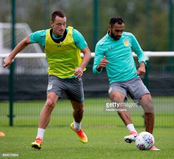 John Terry of Aston Villa in action with team mate Ahmed Elmohamady during a training session at the club's training ground at Bodymoor Heath on...