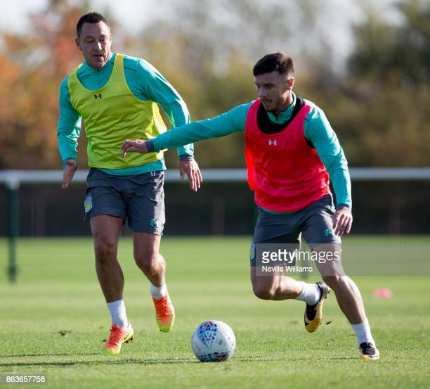 John Terry of Aston Villa in action with team mate Scott Hogan during a training session at the club's training ground at Bodymoor Heath on October...