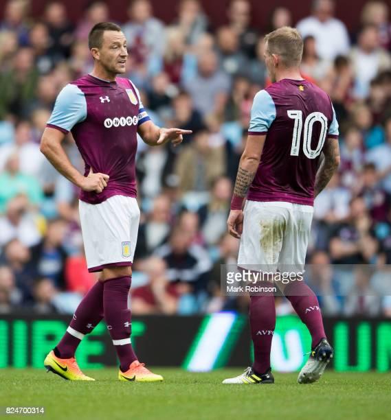 John Terry of Aston Villa talks to his team mate Glenn Whelan during the match between Aston Villa and Watford at Villa Park on July 29 2017 in...
