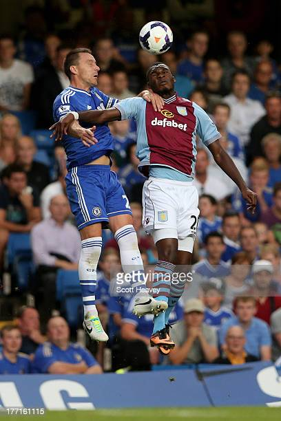John Terry of Chelsea and Christian Benteke of Aston Villa compete for a header during the Barclays Premier League match between Chelsea and Aston...