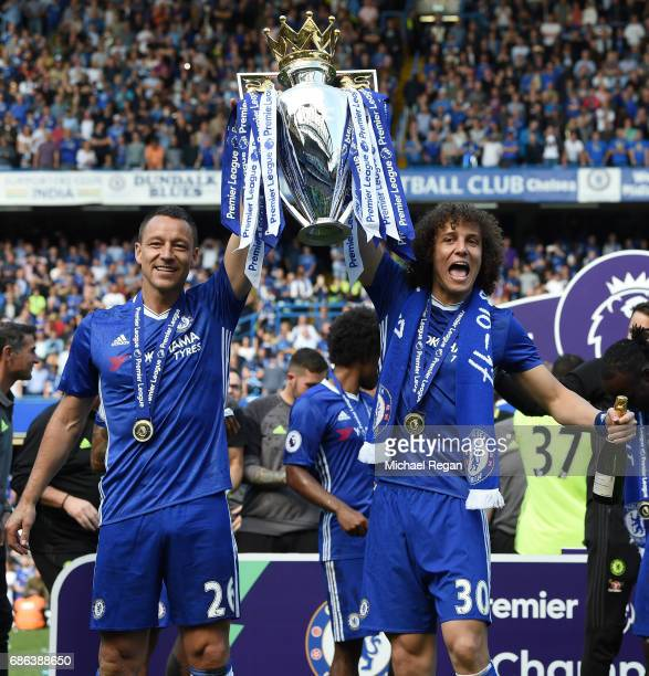 John Terry of Chelsea and David Luiz of Chelsea celebrate with the Premier League Trophy after the Premier League match between Chelsea and...