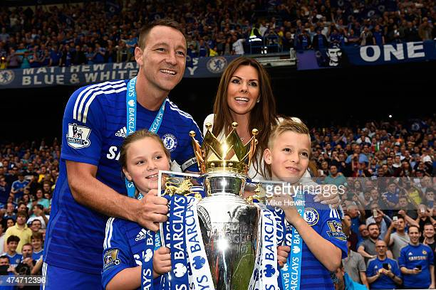 John Terry of Chelsea and family celebrate with the trophy after the Barclays Premier League match between Chelsea and Sunderland at Stamford Bridge...