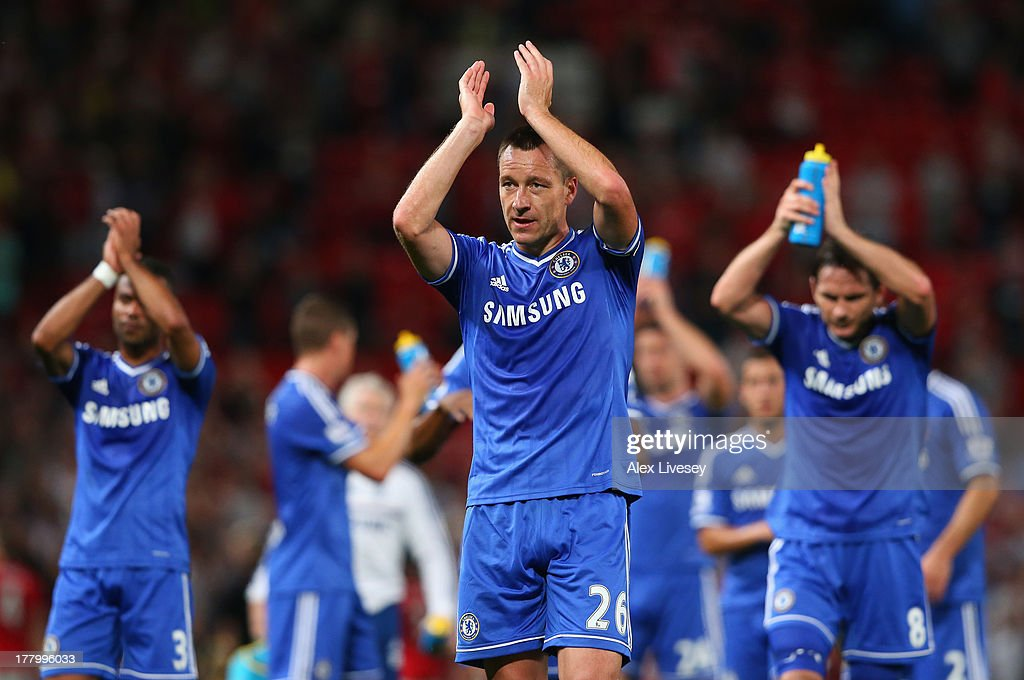 <a gi-track='captionPersonalityLinkClicked' href=/galleries/search?phrase=John+Terry&family=editorial&specificpeople=171535 ng-click='$event.stopPropagation()'>John Terry</a> of Chelsea and his team-mates applaud the fans at the end of the Barclays Premier League match between Manchester United and Chelsea at Old Trafford on August 26, 2013 in Manchester, England.