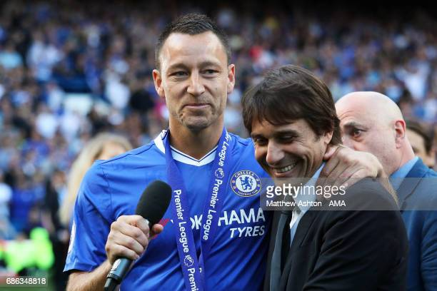 John Terry of Chelsea and Manager / Head Coach Antonio Conte embrace at the end of the Premier League match between Chelsea and Sunderland at...