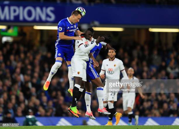 John Terry of Chelsea and M'Baye Niang of Watford battle for possession during the Premier League match between Chelsea and Watford at Stamford...