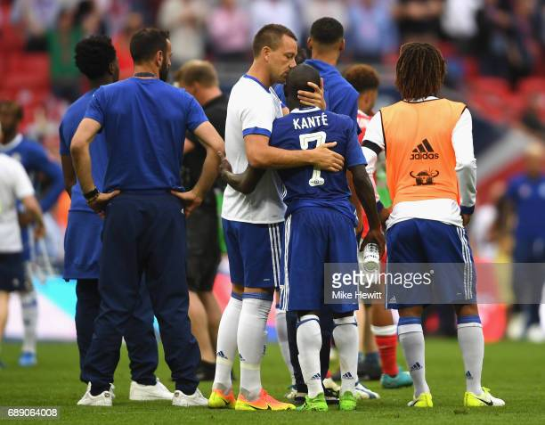 John Terry of Chelsea and N'Golo Kante of Chelsea embrace after The Emirates FA Cup Final between Arsenal and Chelsea at Wembley Stadium on May 27...