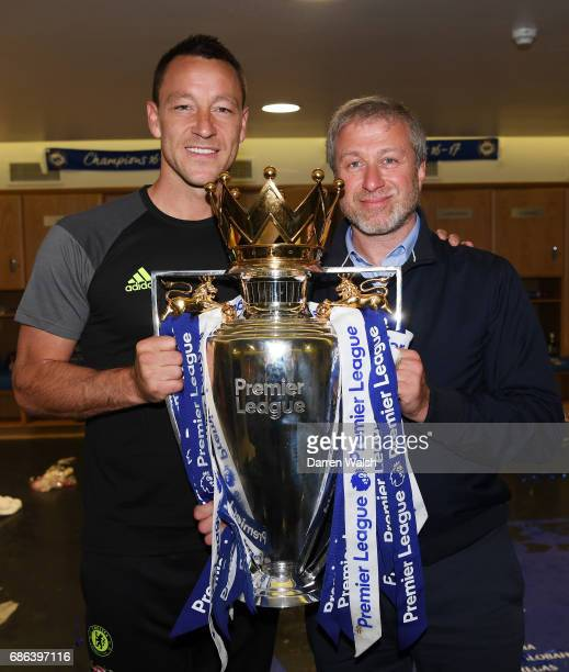 John Terry of Chelsea and Roman Abramovich Chelsea owner pose with the Premier League Trophy in the changing room after the Premier League match...