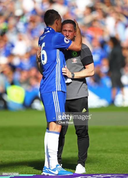 John Terry of Chelsea and Steve Holland Chelsea first team coach embrace after the Premier League match between Chelsea and Sunderland at Stamford...