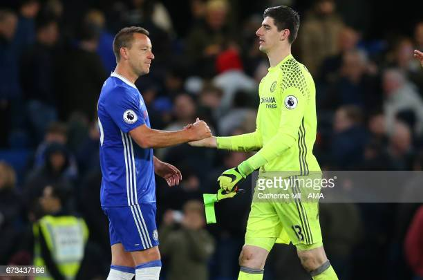 John Terry of Chelsea and Thibaut Courtois of Chelsea during the Premier League match between Chelsea and Southampton at Stamford Bridge on April 25...
