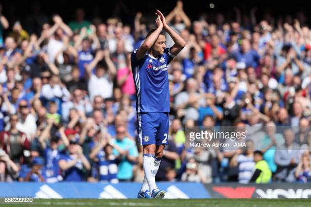 John Terry of Chelsea applauds as he is substituted in the 26th minute in his last match for the club during the Premier League match between Chelsea...
