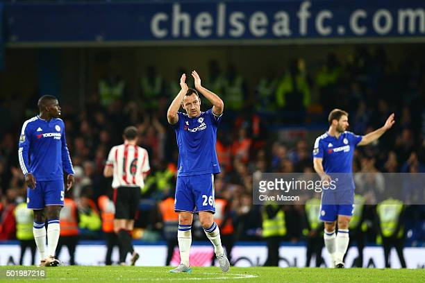 John Terry of Chelsea applauds fans after his team's 31 win in the Barclays Premier League match between Chelsea and Sunderland at Stamford Bridge on...