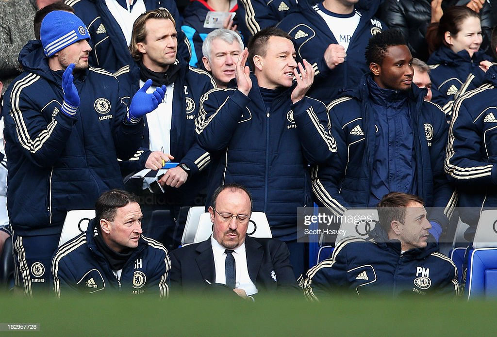 <a gi-track='captionPersonalityLinkClicked' href=/galleries/search?phrase=John+Terry&family=editorial&specificpeople=171535 ng-click='$event.stopPropagation()'>John Terry</a> of Chelsea applauds the opening Chelsea goal as Rafael Benitez, interim manager of Chelsea makes notes during the Barclays Premier League match between Chelsea and West Bromwich Albion at Stamford Bridge on March 2, 2013 in London, England.