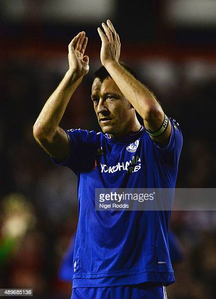 John Terry of Chelsea applauds the travelling fans during the Capital One Cup third round match between Walsall and Chelsea at Banks's Stadium on...
