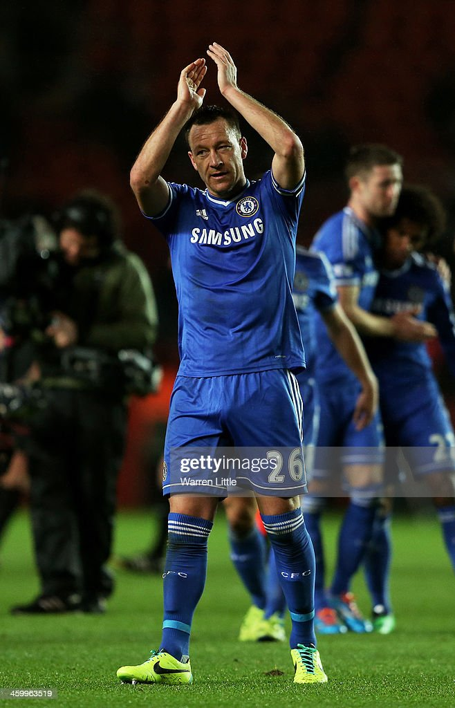 John Terry of Chelsea applauds the travelling fans following his team's 3-0 victory during the Barclays Premier League match between Southampton and Chelsea at St Mary's Stadium on January 1, 2014 in Southampton, England.