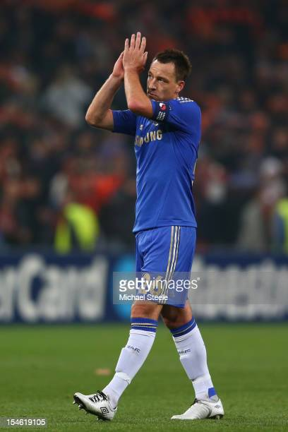 John Terry of Chelsea applauds the travelling supporters after his sides 12 defeat during the UEFA Champions League Group E match between Shakhtar...