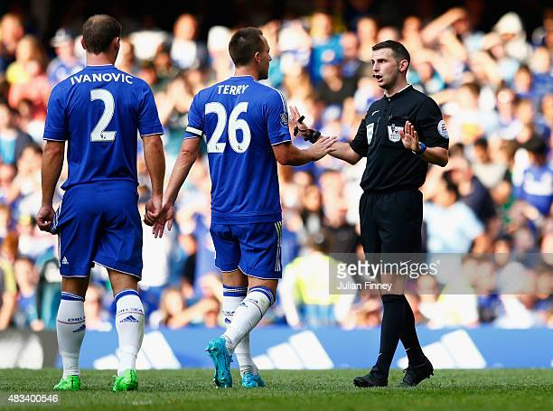 John Terry of Chelsea argues with referee Michael Oliver after the red card to Thibaut Courtois during the Barclays Premier League match between...