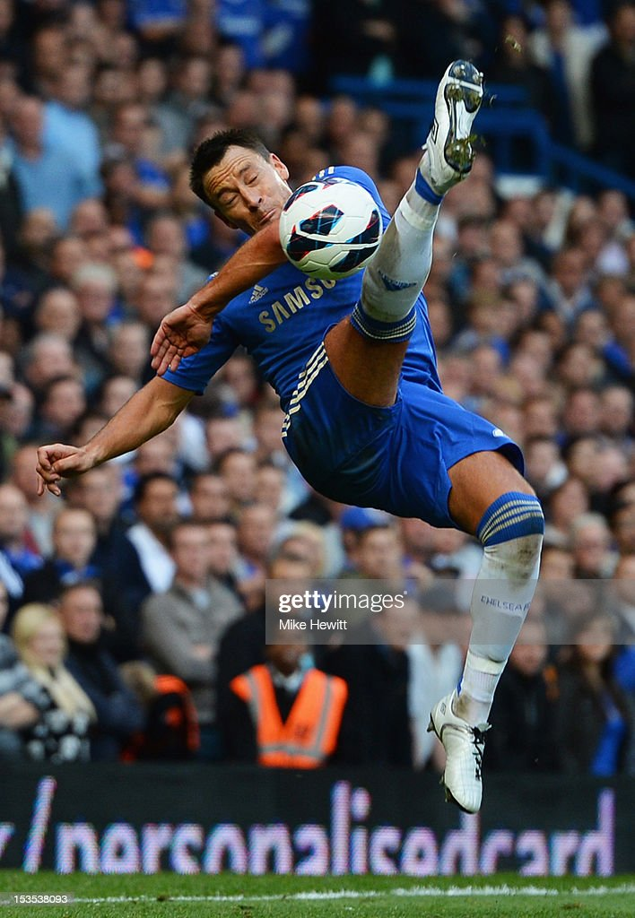 <a gi-track='captionPersonalityLinkClicked' href=/galleries/search?phrase=John+Terry&family=editorial&specificpeople=171535 ng-click='$event.stopPropagation()'>John Terry</a> of Chelsea attempts against the Norwich City overhead kick during the Barclays Premier League match between Chelsea and Norwich City at Stamford Bridge on October 6, 2012 in London, England.