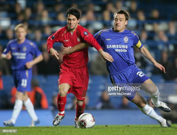 John Terry of Chelsea battles with Luis Garcia of Liverpool during the UEFA Champions League Group G match between Chelsea and Liverpool at Stamford...