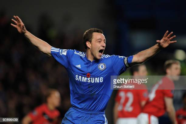 John Terry of Chelsea celebrates after scoring the opening goal during the Barclays Premier League match between Chelsea and Manchester United at...
