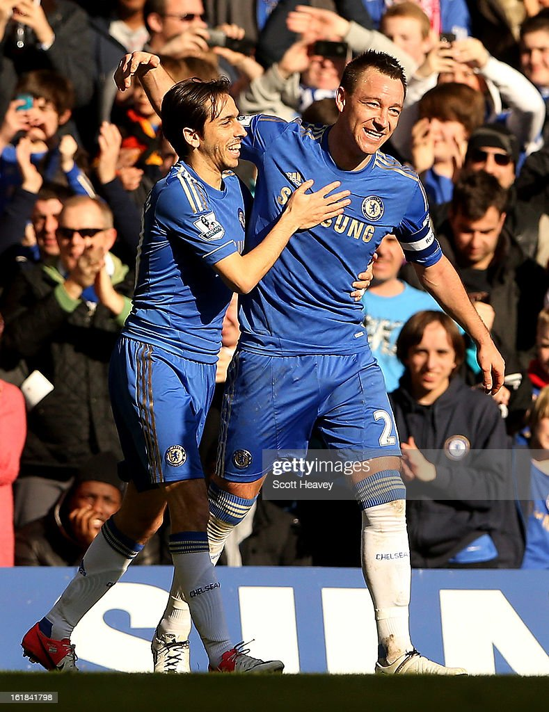 <a gi-track='captionPersonalityLinkClicked' href=/galleries/search?phrase=John+Terry&family=editorial&specificpeople=171535 ng-click='$event.stopPropagation()'>John Terry</a> of Chelsea celebrates after scoring their fourth goal during the FA Cup Fourth Round Replay between Chelsea and Brentford at Stamford Bridge on February 17, 2013 in London, England.