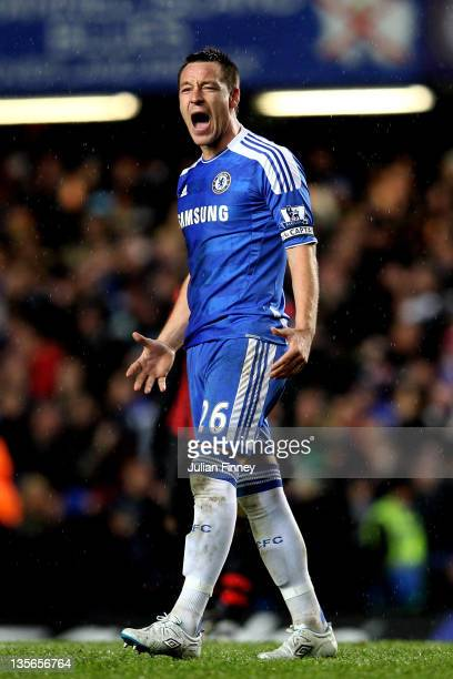 John Terry of Chelsea celebrates after teammate Frank Lampard scores their team's second goal during the Barclays Premier League match between...