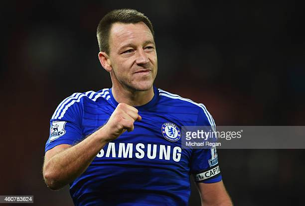 John Terry of Chelsea celebrates after the Barclays Premier League match between Stoke City and Chelsea at Britannia Stadium on December 22 2014 in...