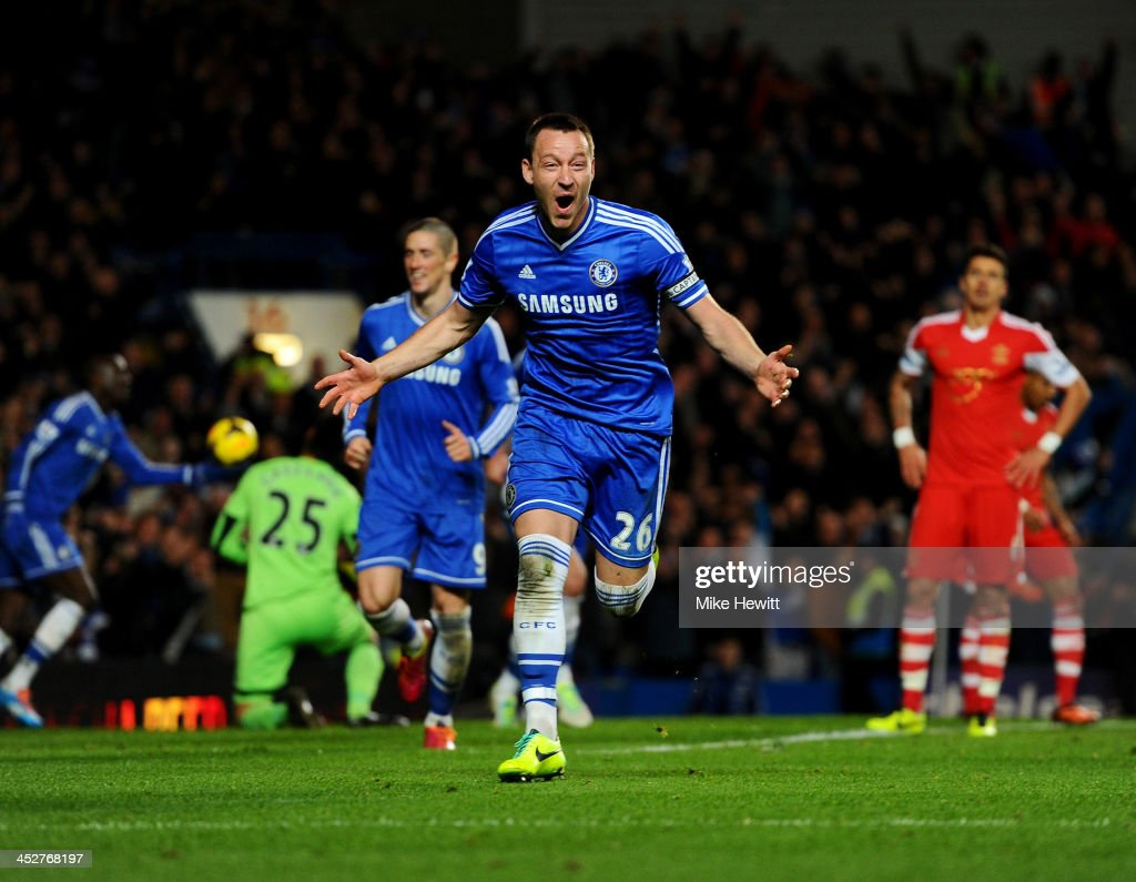 John Terry of Chelsea celebrates as he scores their second goal with a header during the Barclays Premier League match between Chelsea and Southampton at Stamford Bridge on December 1, 2013 in London, England.