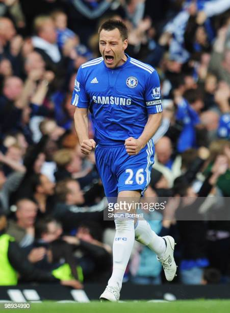 John Terry of Chelsea celebrates as Nicolas Anelka scores their first goal during the Barclays Premier League match between Chelsea and Wigan...