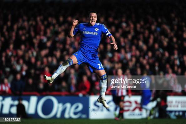 John Terry of Chelsea celebrates as team mate Fernando Torres equalises for their team during the FA Cup with Budweiser Fourth Round match between...