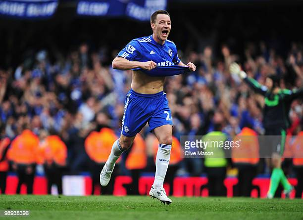 John Terry of Chelsea celebrates as they win the title after the Barclays Premier League match between Chelsea and Wigan Athletic at Stamford Bridge...