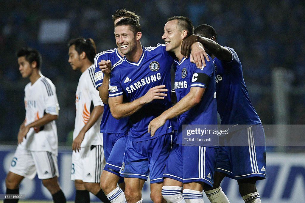 <a gi-track='captionPersonalityLinkClicked' href=/galleries/search?phrase=John+Terry&family=editorial&specificpeople=171535 ng-click='$event.stopPropagation()'>John Terry</a> (R) of Chelsea celebrates his goal with <a gi-track='captionPersonalityLinkClicked' href=/galleries/search?phrase=Gary+Cahill&family=editorial&specificpeople=204341 ng-click='$event.stopPropagation()'>Gary Cahill</a> during the match between Chelsea and Indonesia All-Stars at Gelora Bung Karno Stadium on July 25, 2013 in Jakarta, Indonesia.