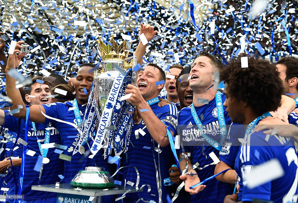 John Terry of Chelsea celebrates lifts the trophy alongside team mates after the Barclays Premier League match between Chelsea and Sunderland at...