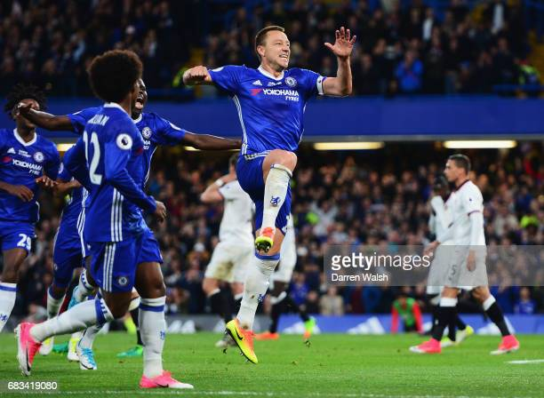 John Terry of Chelsea celebrates scoring his sides first goal during the Premier League match between Chelsea and Watford at Stamford Bridge on May...