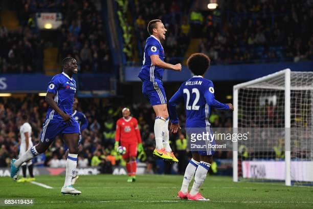 John Terry of Chelsea celebrates scoring his sides first goal with Willian of Chelsea and Kurt Zouma of Chelsea during the Premier League match...