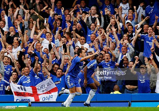 John Terry of Chelsea celebrates scoring the first goal of the game in front of the fans during the Barclays Premiership match between Chelsea and...