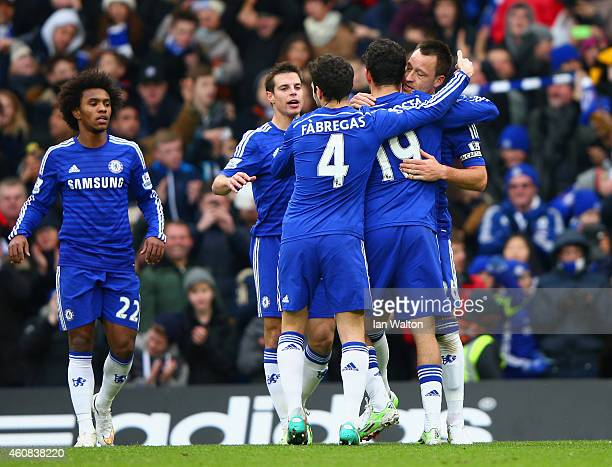 John Terry of Chelsea celebrates scoring the opening goal with Diego Costa and Cesc Fabregas of Chelsea during the Barclays Premier League match...