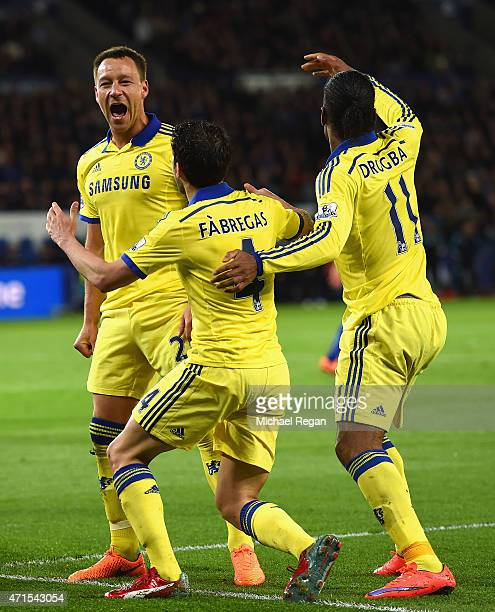 John Terry of Chelsea celebrates scoring their second goal with Cesc Fabregas and Didier Drogba of Chelsea during the Barclays Premier League match...