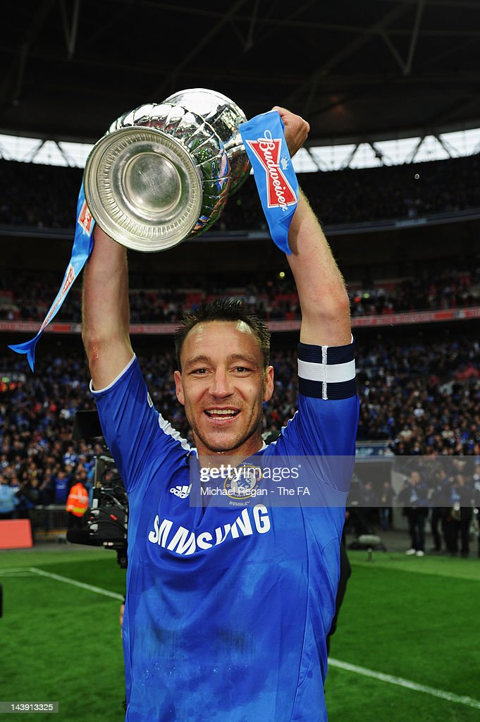 <a gi-track='captionPersonalityLinkClicked' href=/galleries/search?phrase=John+Terry&family=editorial&specificpeople=171535 ng-click='$event.stopPropagation()'>John Terry</a> of Chelsea celebrates victory with the trophy in the FA Cup Final with Budweiser between Liverpool and Chelsea at Wembley Stadium on May 5, 2012 in London, England.