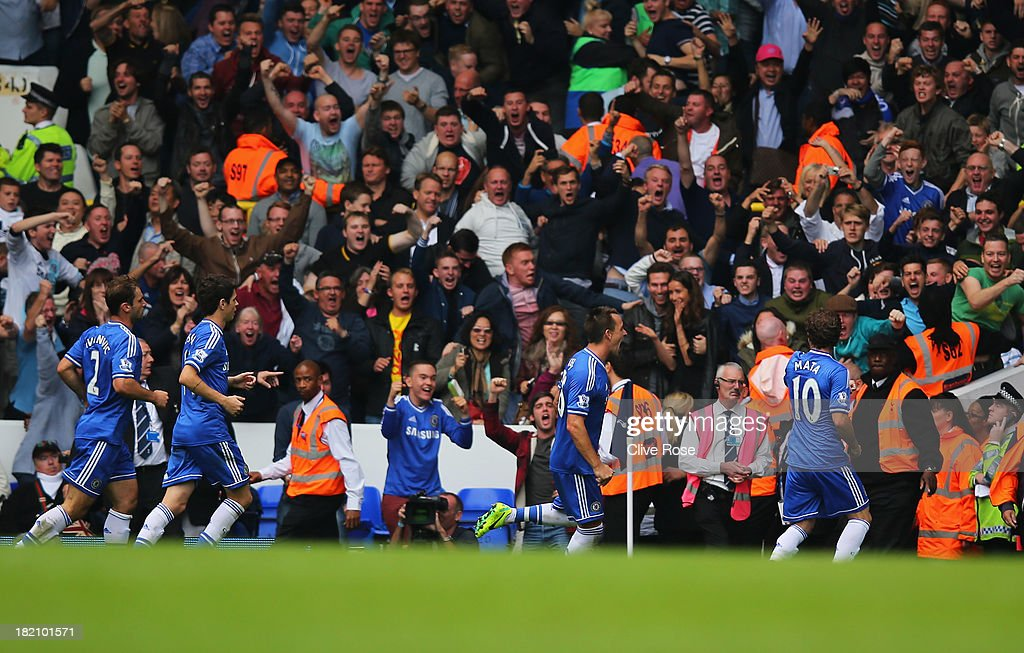 <a gi-track='captionPersonalityLinkClicked' href=/galleries/search?phrase=John+Terry&family=editorial&specificpeople=171535 ng-click='$event.stopPropagation()'>John Terry</a> of Chelsea (2R) celebrates with fans and team mates as he scores their first goal with a header during the Barclays Premier League match between Tottenham Hotspur and Chelsea at White Hart Lane on September 28, 2013 in London, England.