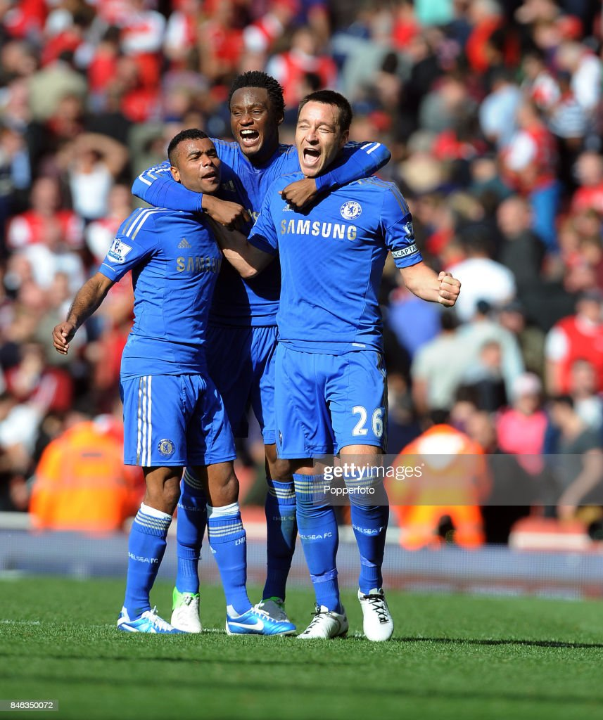 John Terry of Chelsea (right) celebrates with his team mates Ashley Cole (left) and John Obi Mikel after winning the Barclays Premier League match between Arsenal and Chelsea at the Emirates Stadium on September 29, 2012 in London, England.