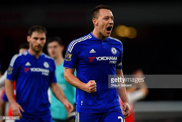 John Terry of Chelsea celebrates with his teammates after the Barclays Premier League match between Arsenal and Chelsea at Emirates Stadium on...